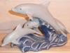 Drei Delphine springend